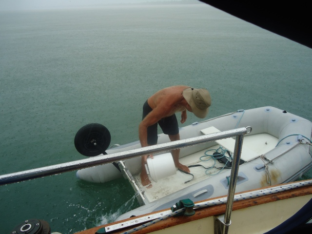 Peter bailing water out of the dinghy